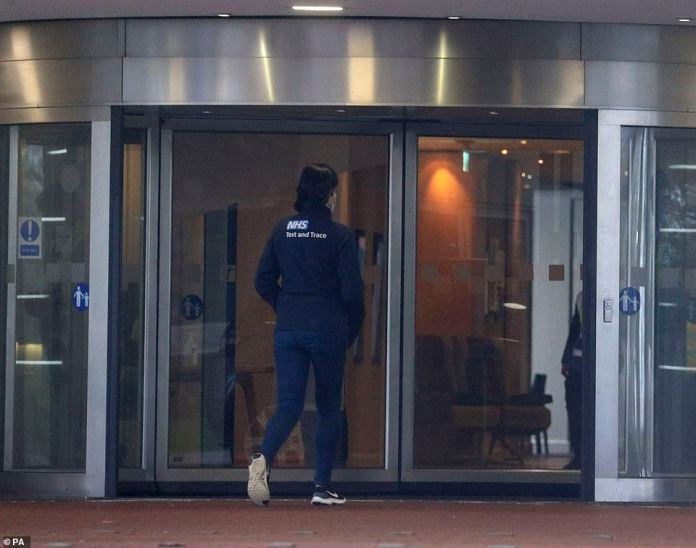 A member of NHS Test and Trace staff walks into the Holiday Inn hotel near London Heathrow Airport yesterday