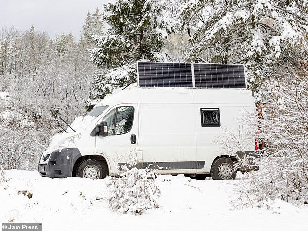 While life on the road is far more relaxing than Rachel's former life in the UK, it still has its challenges as she said things 'break all the time' and it's 'cramped', as well as meeting hostility from other people (pictured, the van parked up in the snow)