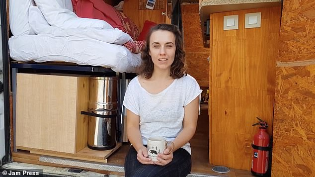 The couple have no plans to settle down in a 'normal' house in the future - though they would settle somewhere permanently if it was environmentally-efficient (pictured: Rachel sitting in the van)