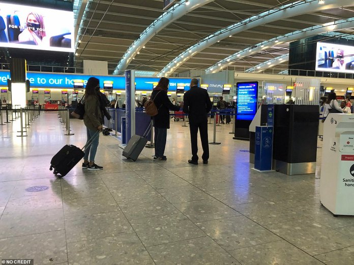 The first passengers at Heathrow Airport Terminal 5 departures taking advantage of the easing of travel restrictions today