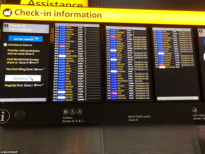 The departures board at Heathrow Airport Terminal 5 this morning as global travel restrictions are eased today