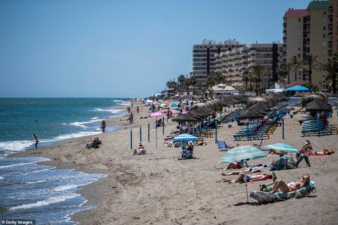 Fuengirola beach near Malaga is pictured today as UK holidaymakers set their sights on a trip to Spain