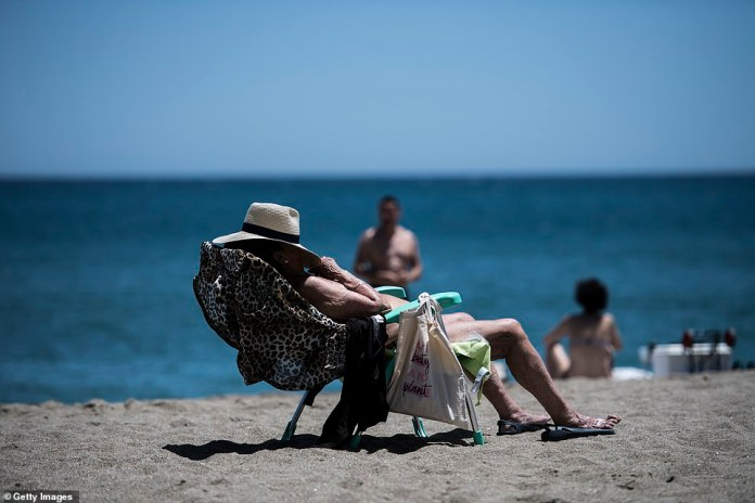 The bright sunlight in Fuengirola is too much for this woman enjoying a break on the beach as she pulls her hat over her eyes to have a nap