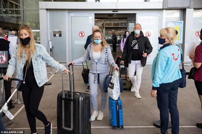 British tourists arrive at Malaga Airport today after Spain lifted the travel ban on holidaymakers arriving from the UK