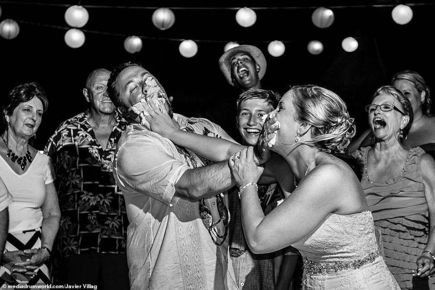 Sweet! Photographer Javier Villagran, from Madrid, Spain, was awarded one of the top prizes with the image of a couple cramming cake into one another's mouths while their guests watched on in delight