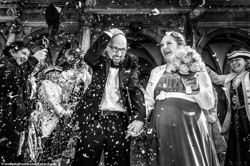 Overwhelmed:Katrin Kuellenberg, from Germany, snapped one of the more traditional wedding moments, captured a pregnant bride and her groom being showered with confetti by their eager guests as they emerged from their ceremony