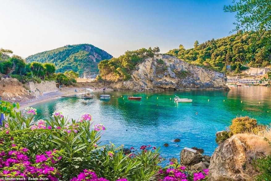 Glorious Greece: Return flights are available to Santorini, Rhodes, Corfu and Athens from less than £75 in August. Pictured is Paleokastritsa Bay in Corfu