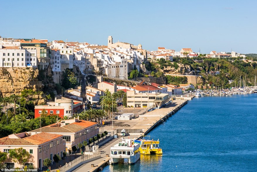 Whitehall sources are increasingly confident that France will be removed from the 'amber plus' list, which requires people to self-isolate for ten days on return even if fully vaccinated. Pictured, Mahon, the capital city of Menorca in Spain