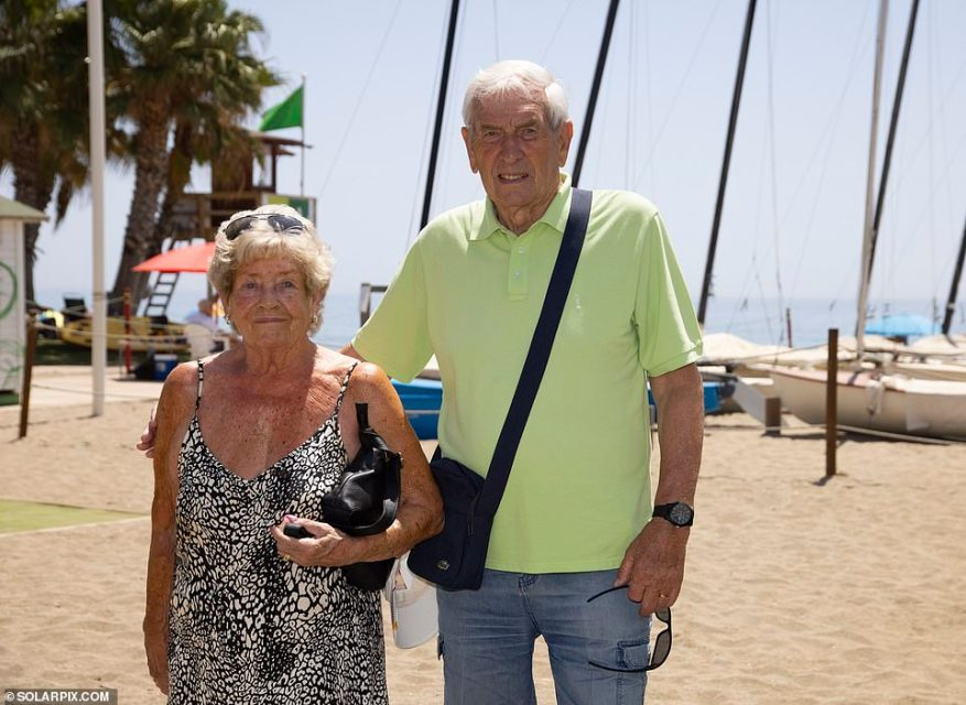 Retired police officer Stan Hegarty, enjoying a beer at a beachfront bar in La Cala de Mijas near Fuengirola with wife June, said: 'We rent a property here and fly back and forth several times a year