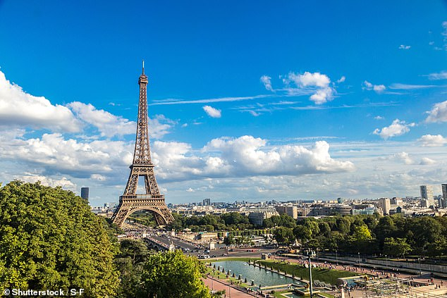 Plans for an 'amber watch list' have sparked uproar in Whitehall, with some ministers warning the scheme could wreck the hopes of millions of Britons. Pictured: Eiffel Tower in Paris