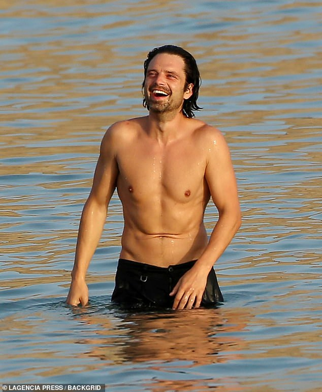 Having the best time:Sebastian enjoyed a dip in the ocean soon after while Alejandra dried on the shore