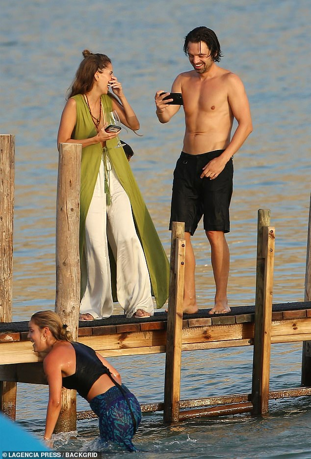 Hilarious: Sebastian filmed his girlfriend as she got out of the water fully clothed