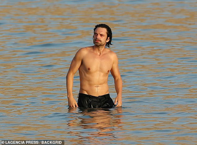 Handsome: The Falcon and The Winter Soldier star showcased his form as well as his good looking features as he paused in the water