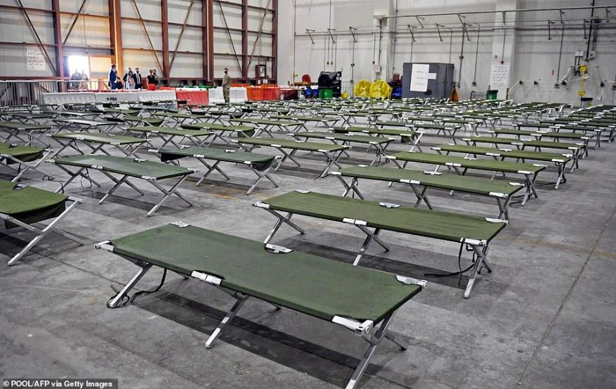 Cots line the floor of a building on the Doha base where Afghan refugees are processed before being transfered to the U.S.