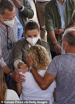 Queen Letizia could be seen leaning in to comfort a woman affected by the eruption of the Cumbre Vieja volcano