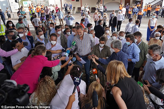 Queen Letizia and King Felipe were swarmed by reporters as they offered statements during their visit to the area