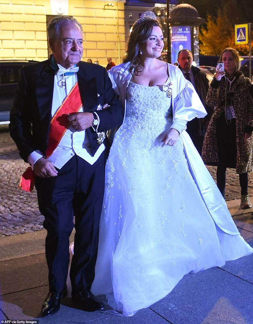 Victoria Romanovna Bettarini accompanied by her father, Roberto Bettarini, arrives to attend a dinner after her wedding with Grand Duke George Mikhailovich Romanov in Saint Petersburg.