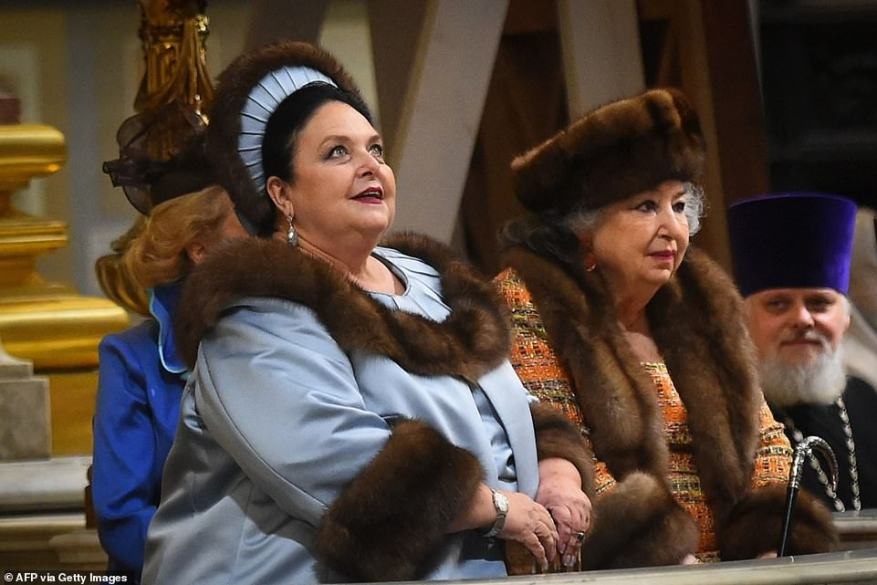 Glowing with pride! Mother-of-the-groomGrand Duchess Maria Vladimirovna of Russia cut a resplendent figure in a blue jacket and headpiece with fur trim.