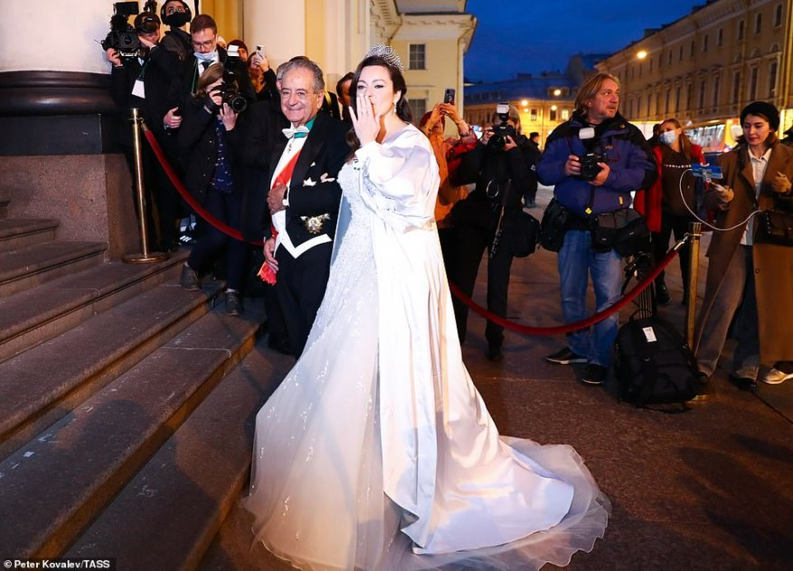 Rebecca Bettarini of Italy is accompanied by her father, diplomat Roberto Bettarini prior to a reception at the Russian Museum of Ethnography.