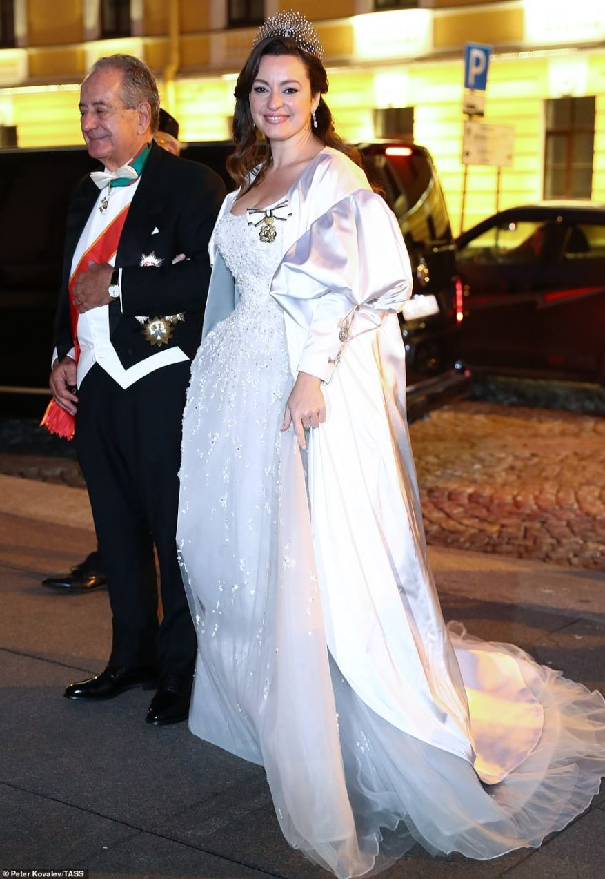 Rebecca (Victoria) Bettarini of Italy is accompanied by her father, diplomat Roberto Bettarini prior to a reception at the Russian Museum of Ethnography marking her wedding.