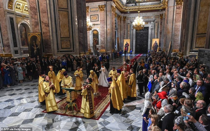 Grand Duke George Mikhailovich Romanov and Victoria Romanovna Bettarini attend their wedding ceremony at the Saint Isaac's Cathedral in Saint Petersburg, on October 1.