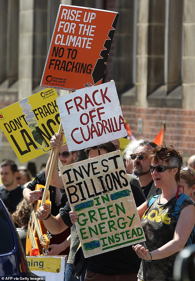 Under the ground in Lancashire, and other parts of north and central England, are vast reserves of gas which could be fracked to the surface to save the day. Pictured: Anti-fracking demonstrators in 2015