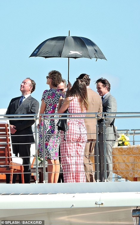 Sun: An umbrella was held up to shield her from the rays