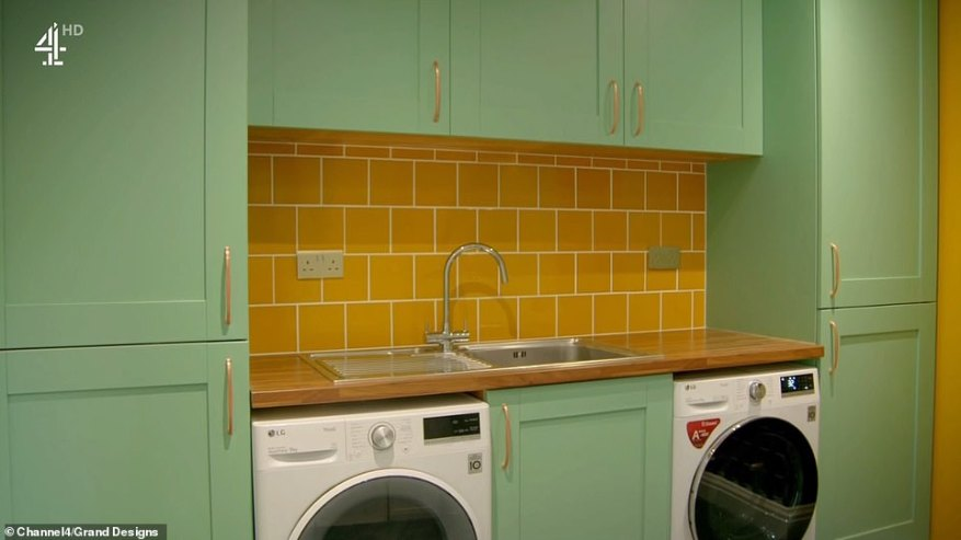 The utility room featured mustard-coloured tiles and pastel green units which were not to everyone's tastes (pictured)