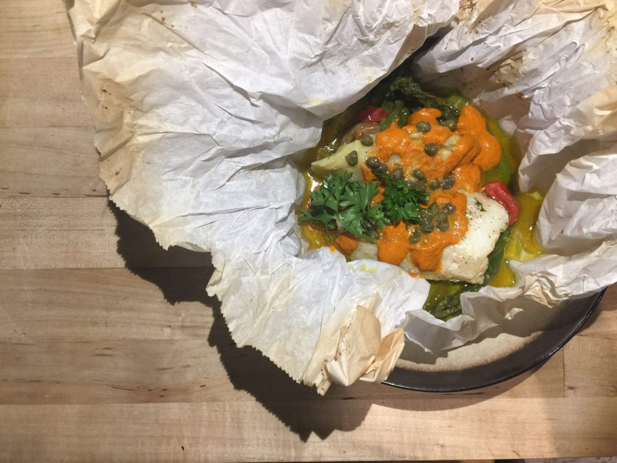 Cod cooked en papillote as example of a light dish for summer.