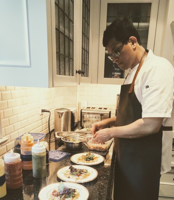 Chef Cesar plating a salad.