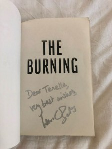 My signed copy of The Burning by Laura Bates