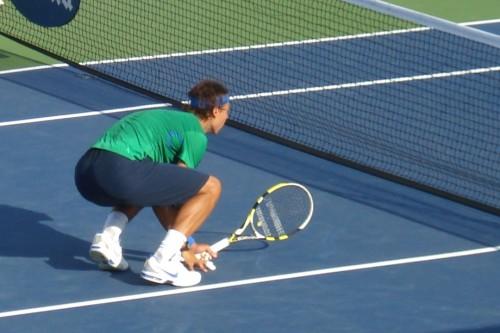 Rafael Nadal crouching at net Cincinnati Open 2011 green shirt pictures photos images racquet