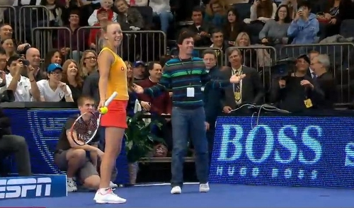 Caroline Wozniacki Rory McIlroy Madison Square Garden exhibition match racquet yellow red dress funny pictures images photos 2012