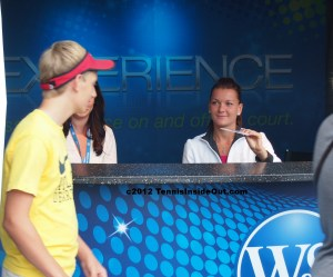 Agnieszka Radwanska signing autographs Cincinnati Open Western and Southern 2012 smile