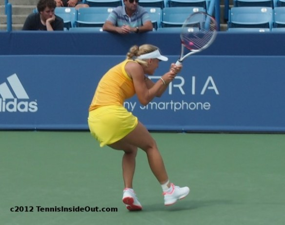 Caroline Wozniacki Caro dig point crouching backhand Cincinnati Western and Southern Open by Valerie David pictures images photos 2012