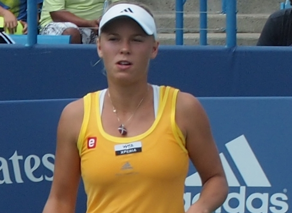 Western and Southern Open Caroline Wozniacki yellow kit white visor squint photos pictures by Valerie David 2012