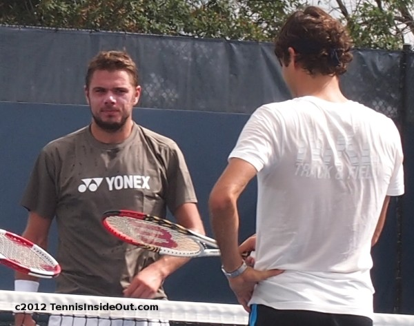 Stan Wawrinka giving side eye to Roger Federer Western and Southern Open Cincinnati 2012 chat talk practice white tee Yonex tee racquets photos pictures images screencaps