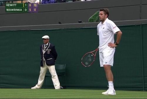 Stan Wawrinka hands on hips Wimbledon pictures photos white shirt shorts