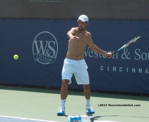 Feli Lopez Western and Southern Open forehand swing tennis ball shirtless pecs abs white hat shorts pictures photos