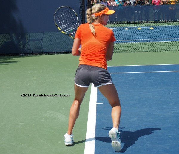 Genie Bouchard backhand sweaty clingy shirt short shorts bare legs hot pictures great ass bum arse behind bottom photos