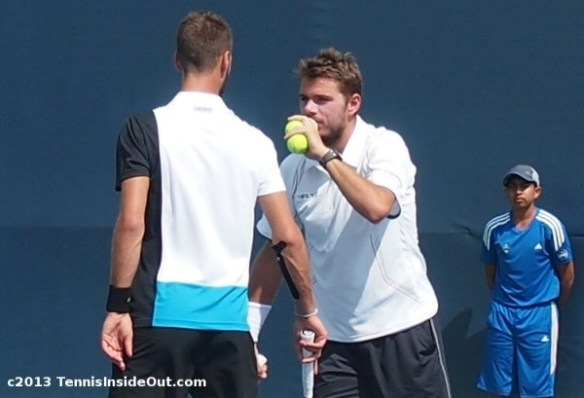 Stan and Benoit Wawrinka Paire Wawaire doubles chat secrets strategy whispering behind tennis balls covering mouth Cincinatti Open tennis match