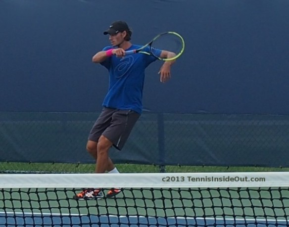Christian Groh Haas coach marionette pose bent elbow on forehand follow-through tennis photos