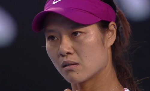 Li Na grim challenging expression to Domi Cibulkova Australian Open final red-violet pink visor photos pictures funny