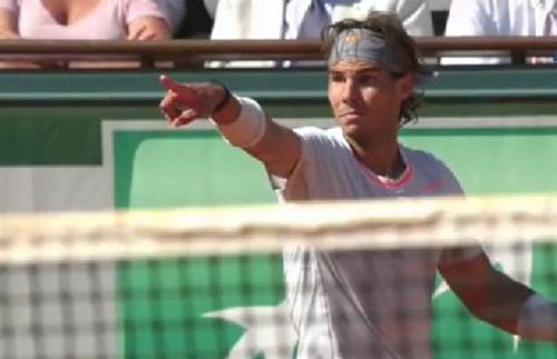 Rafael Nadal point Djokovic net touch Roland Garros French Open semifinal match 2013 photos