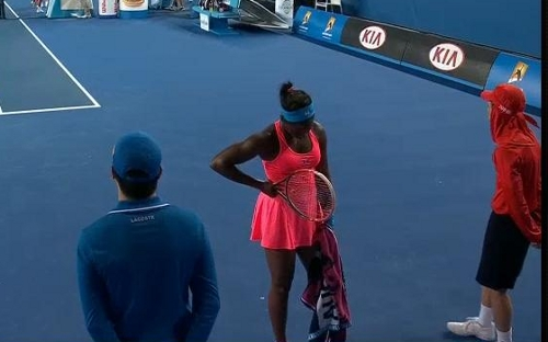 Sloane Stephens struggling in her match against Tomljanovic neon coral dress turquoise headband hands on hips