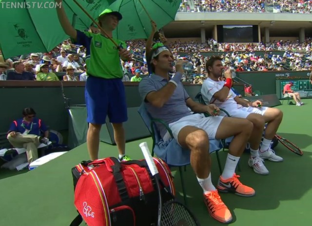 Stan and Roger in unison drinking water bottles 1st round doubles IW 2014