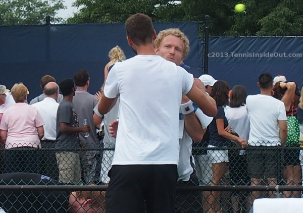 Dmitry Tursunov Benoit Paire cheek kiss snog smoosh hug