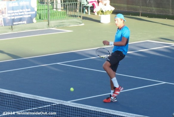 Martin Redlicki kicking a missed ball after point Winnetka challenger Nielsen tennis champs