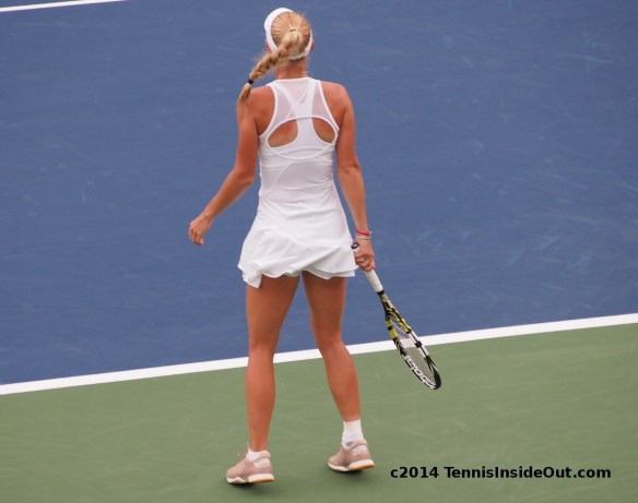 Caroline Wozniacki Stella McCartney white ruffled dress sheer cut-out back gorgeous fashion bouncing reading to return serve Cincinnati Premier Western and Southern Open WTA