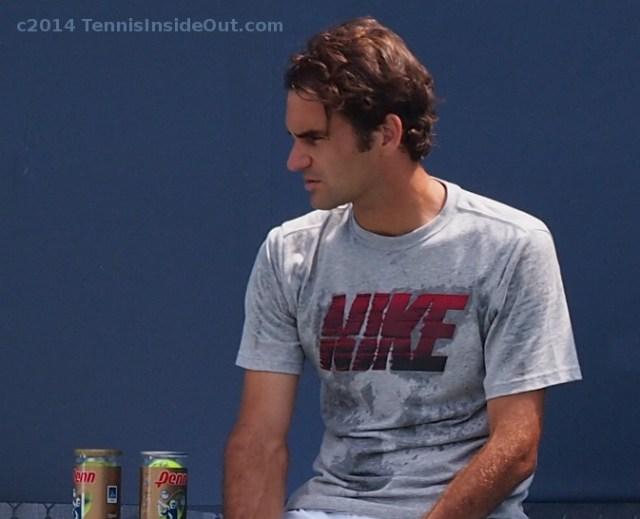 Roger Federer curls sweaty Nike t-shirt